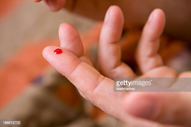 Drop Of Blood On Fingertip