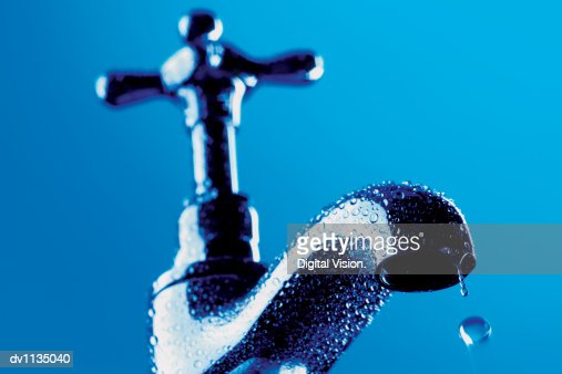 Drop of Water Falling From a Faucet : Stock Photo