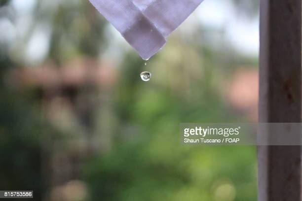 Drop of water falling from cloth