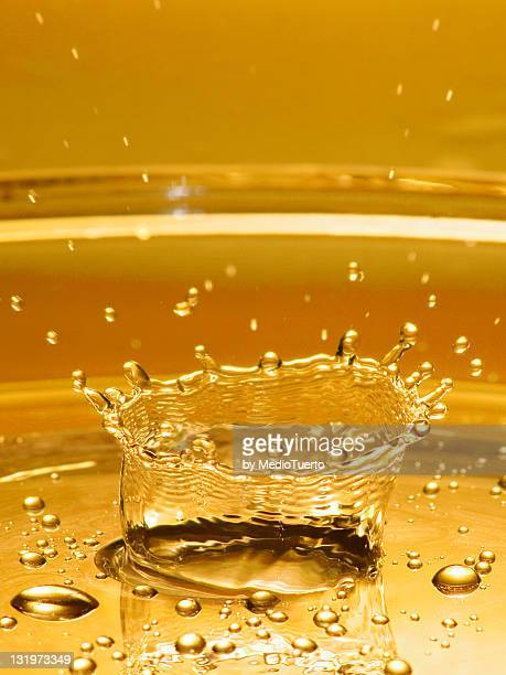 Drop of water hitting surface and forming crown