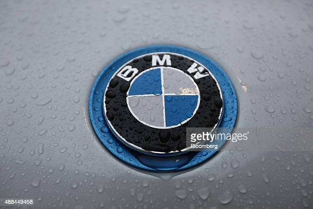 Droplets of rainwater rest on a BMW i8 plugin hybrid automobile produced by Bayerische Motoren Werke AG outside the IAA Frankfurt Motor Show in...