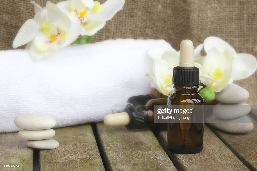 Dropper bottles pure orchid essential oil. Closeup : Stock Photo