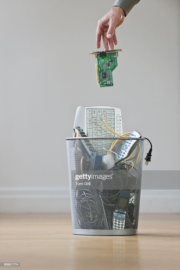 dropping computer chip into trash can : Stock Photo