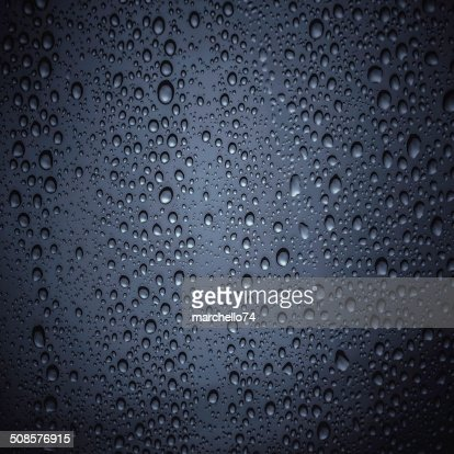 Drops of water on dark color glass : Stock Photo