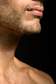 Drops of water on man's lips and neck, close-up