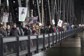 Droves of demonstrators march over Steel Bridge in November 17 2011 in Portland Oregon The Occupy Portland movement joined the nationwide N17...