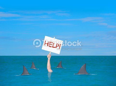 drowning depressed man in with help sign surrounded by sharks