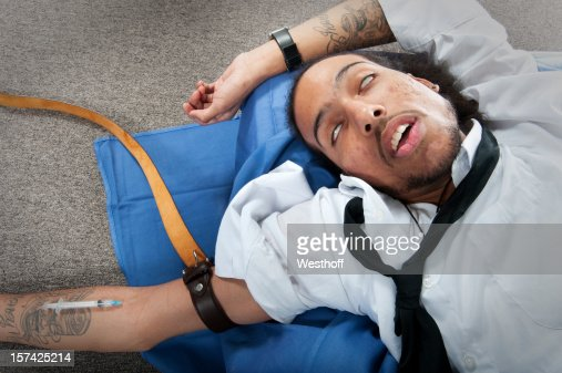 Drug addiction tattoos stock photos and pictures getty for Substance abuse tattoos