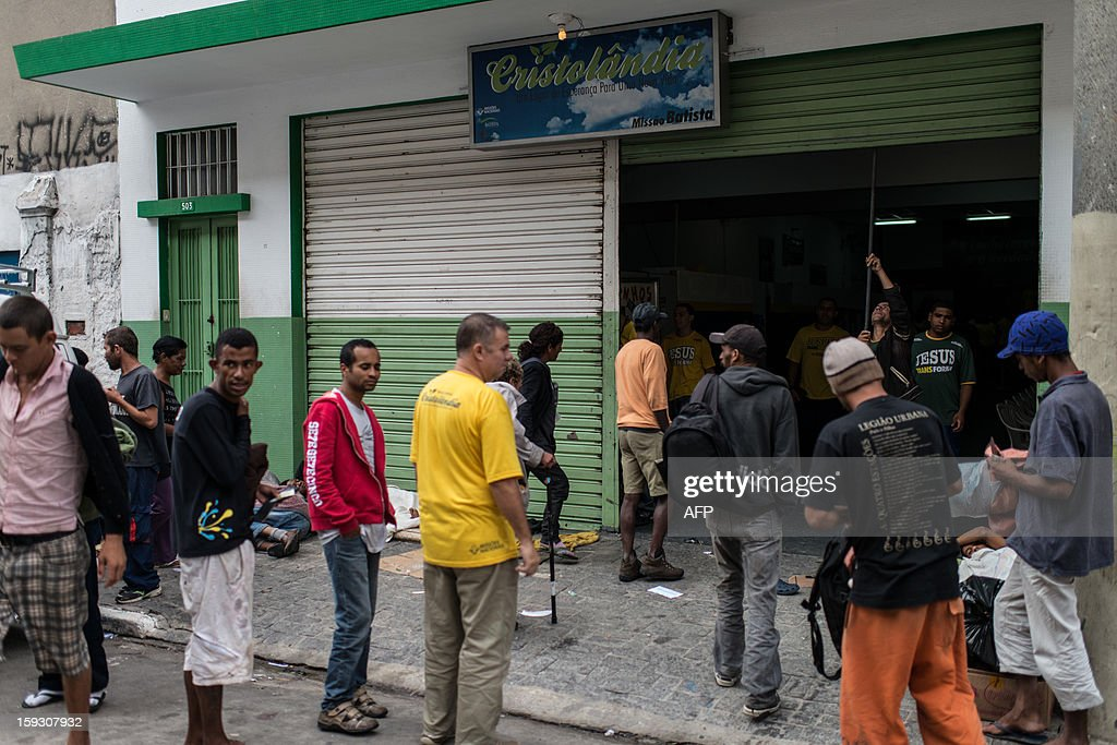 Drug addicts and homelesses enter to 'Cristolandia', a Christian church offering free breakfast, lunch, shower or haircut, at so called 'Crackolandia', a place where drug users gathering to smoke crack cocaine, in downtown Sao Paulo, Brazil on January 11, 2013. AFP PHOTO/Yasuyoshi CHIBA