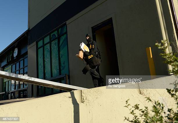 Drug Enforcement Agency officials raids VIP Cannabis located at 2949 W Alameda Ave April 30 2014 The marijuana dispensary was previously raided in...