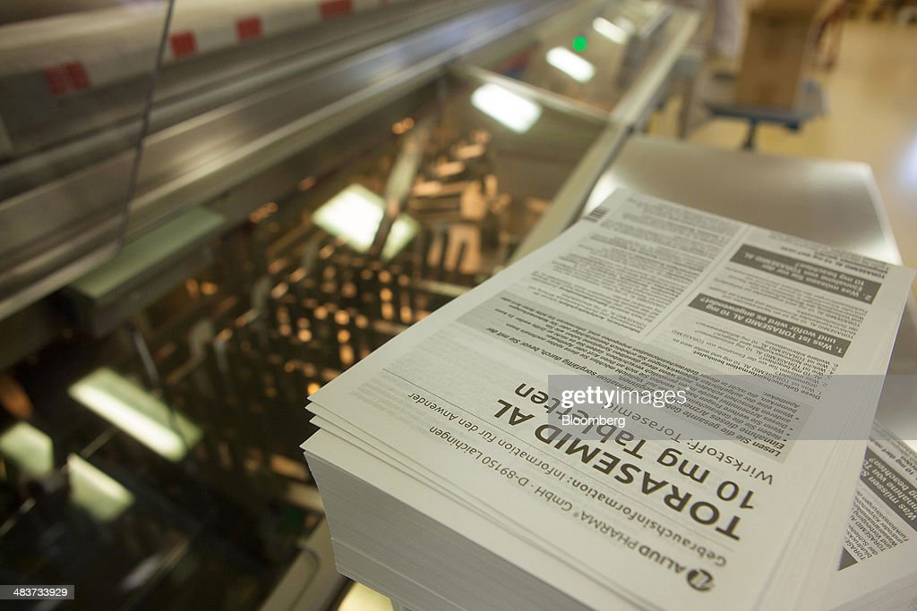 Drug information sheets sit stacked beside an Uhlmann Blister Express Center 500 packaging machine at the Stada Arzneimittel AG pharmaceutical factory in Bad Vilbel, Germany, on Wednesday, April 9, 2014. Last month Stada Arzneimittel AG climbed 2.7 percent after Deutsche Bank AG upgraded its rating on the maker of generic drugs. Photographer: Krisztian Bocsi/Bloomberg via Getty Images
