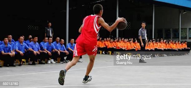 Drug rehab patient plays a basketball game wearing uniforms of National Basketball Association team in a compound at the Kunming Municipal Compulsory...