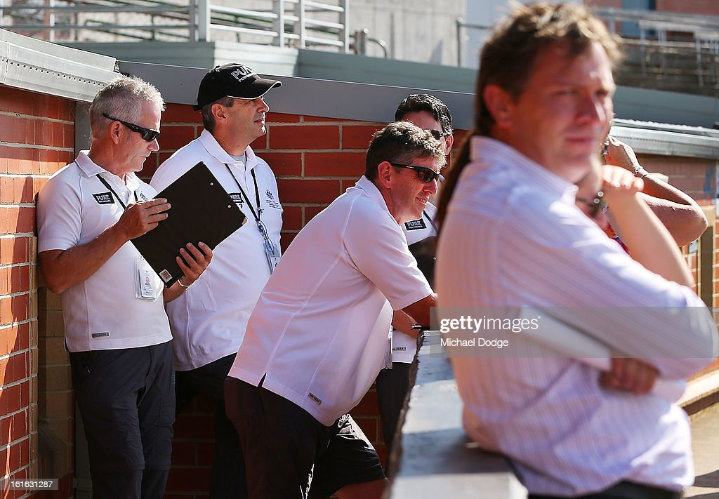Drug testers wait to go into the club rooms during a Essendon Bombers AFL training session at Windy Hill on February 14, 2013 in Melbourne, Australia.