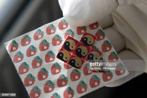 Drugs and drugtaking equipment a sheet of LSD tabs