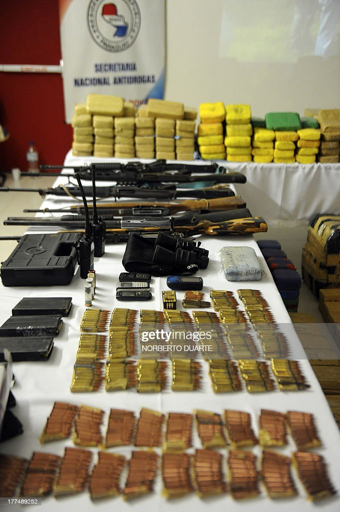 Drugs and weapons seized during the Aguila Negra (Black Eagle) operation carried out in the EEP guerrillas-controlled area, in Asuncion on August 23, 2013. 1726 kg of cocaine and 1726 kg of marijuana worth USD 100 million were seized, General Prosecutor Javier Diaz Veron said. AFP PHOTO/NORBERTO Duarte