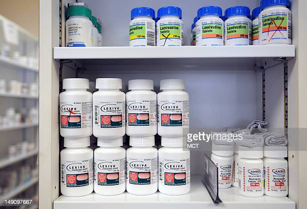 AIDS drugs fill the shelves at the pharmacy Junly 19 where patients can pick up their prescription drugs after consulting one of the health care...