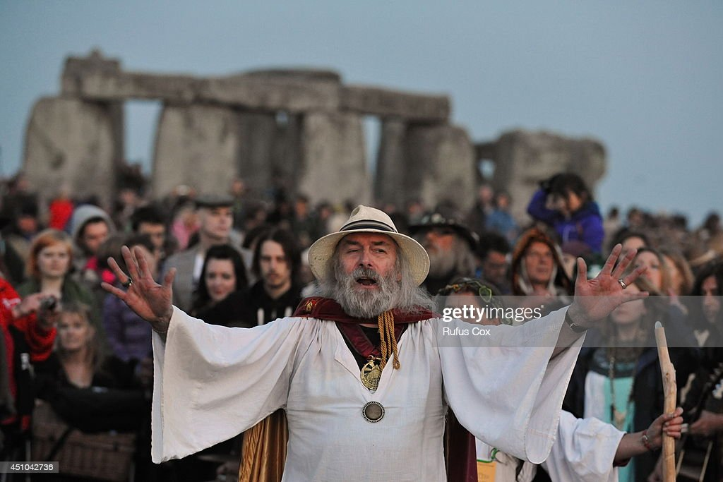 A druid conducts a ceremony before sunrise to mark the summer solstice at Stonehenge prehistoric monument on June 21, 2014 in Wiltshire, England. An estimated 37,000 revellers and modern day druids gathered at Stonehenge, a tradition dating back thousands of years, to celebrate the solstice and watch the sunrise.