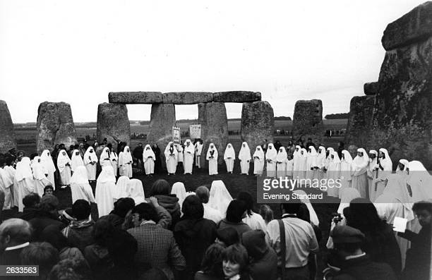 Druids a religious sect practise their art at the ruins in Stonehenge during the midsummer solstice