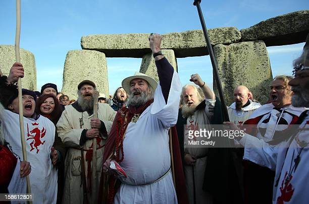 Druids conduct a ceremony following the traditional winter solstice celebrations at Stonehenge to coincide with the supposed Mayan Apocalypse on...
