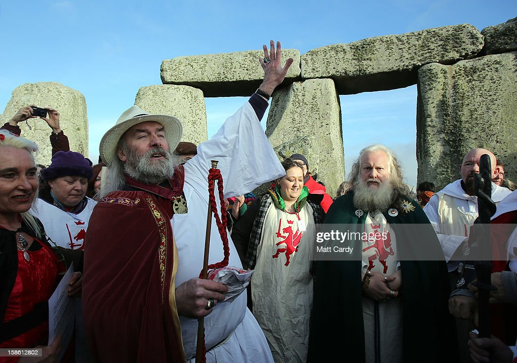 Druids conduct a ceremony following the traditional winter solstice celebrations at Stonehenge to coincide with the supposed Mayan Apocalypse, on December 21, 2012 in Wiltshire, England. Predictions that the world will end today as it marks the end of a 5,125-year-long cycle in the ancient Maya calendar, encouraged a larger than normal crowd to gather at the famous historic stone circle to celebrate the sunrise closest to the Winter Solstice, the shortest day of the year.