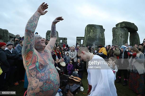 Druids pagans and revellers gather in the centre of Stonehenge as they take part in a winter solstice ceremony at the ancient neolithic monument of...