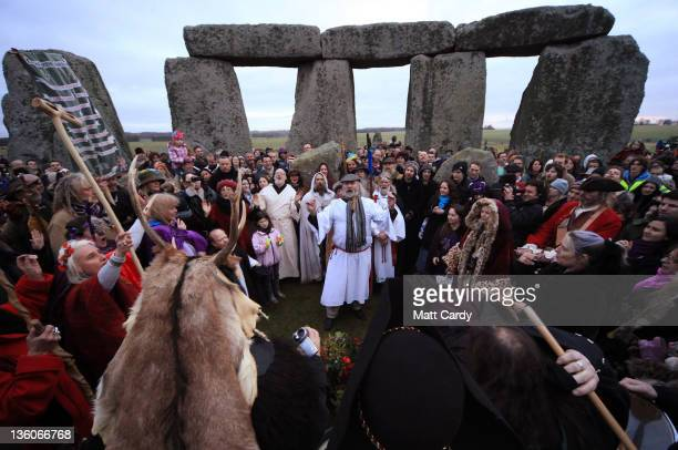 Druids pagans and revellers take part in a winter solstice ceremony at Stonehenge on December 22 2011 in Wiltshire England The unseasonable warm...