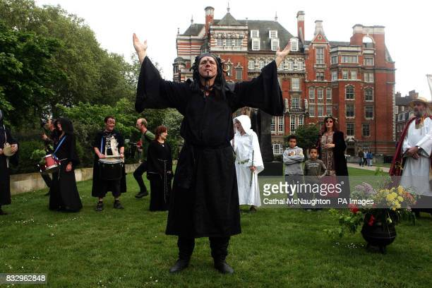Druids representing multiple Druid orders take part in a Beltane ceremony to welcome spring in Abingdon Green central London