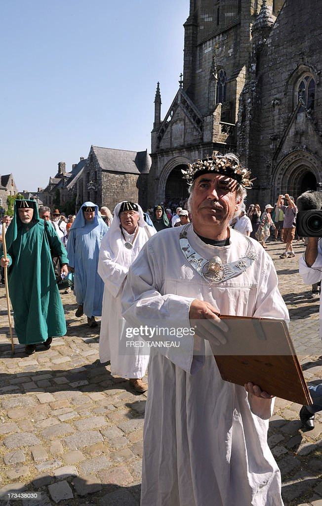 Druids take part in the 'Grande Tromenie', on July 14, 2013 in Locronan in Brittany, western France, one of the oldest Breton 'pardons', a procession which gathers thousands of Catholic pilgrims. The religious event old of at least 500 years takes place every six years, gathering thousands of pilgrims who walk and pray, following 5th and 6th century Irish evangelist monk Saint-Ronan's footsteps.