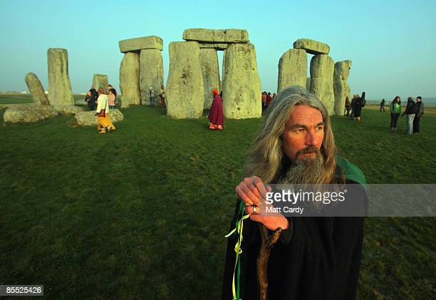 Druids watch the sunrise as they celebrate the Spring Equinox at Stonehenge on March 20 2009 near Amesbury Wiltshire England Several hundred druids...