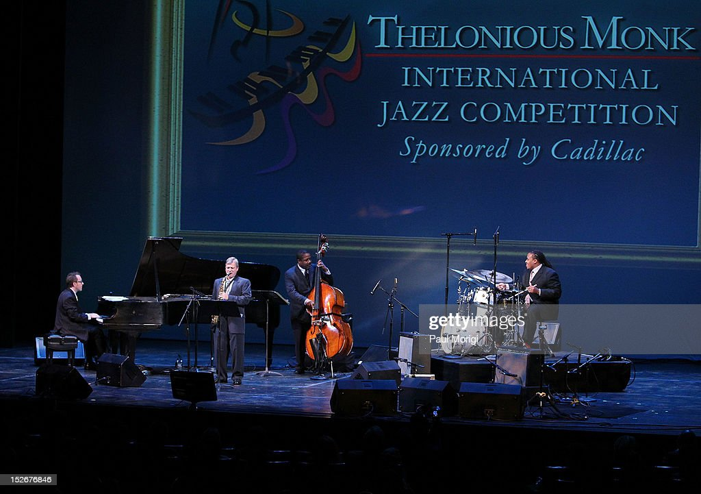 Drum competition winner Jamison Ross (R) performs at the Thelonious Monk International Jazz Drums Competition and Gala Concert at The Kennedy Center on September 23, 2012 in Washington, DC.