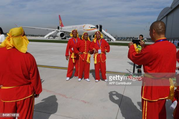 TOPSHOT Drum dancers pose for photos in front of the first Airbus A330 plane to be delivered before the inauguration ceremony of the Airbus A330...