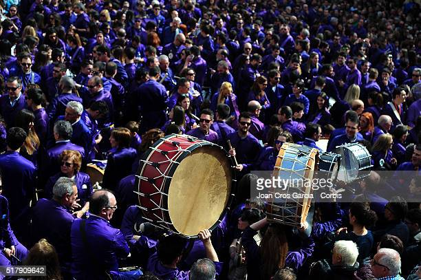 A drum is held aloft over a crowd of festival participants during Holy Week celebrations on March 25 2016 in Calanda Spain