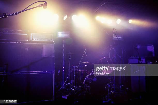 Drum kit on spotlighted stage