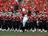 A drum major leads the Wisconsin Badger band onto the field before a game against the Arizona State Sun Devils at Camp Randall Stadium on September...