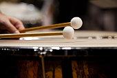 Drum sticks hitting the timpani closeup