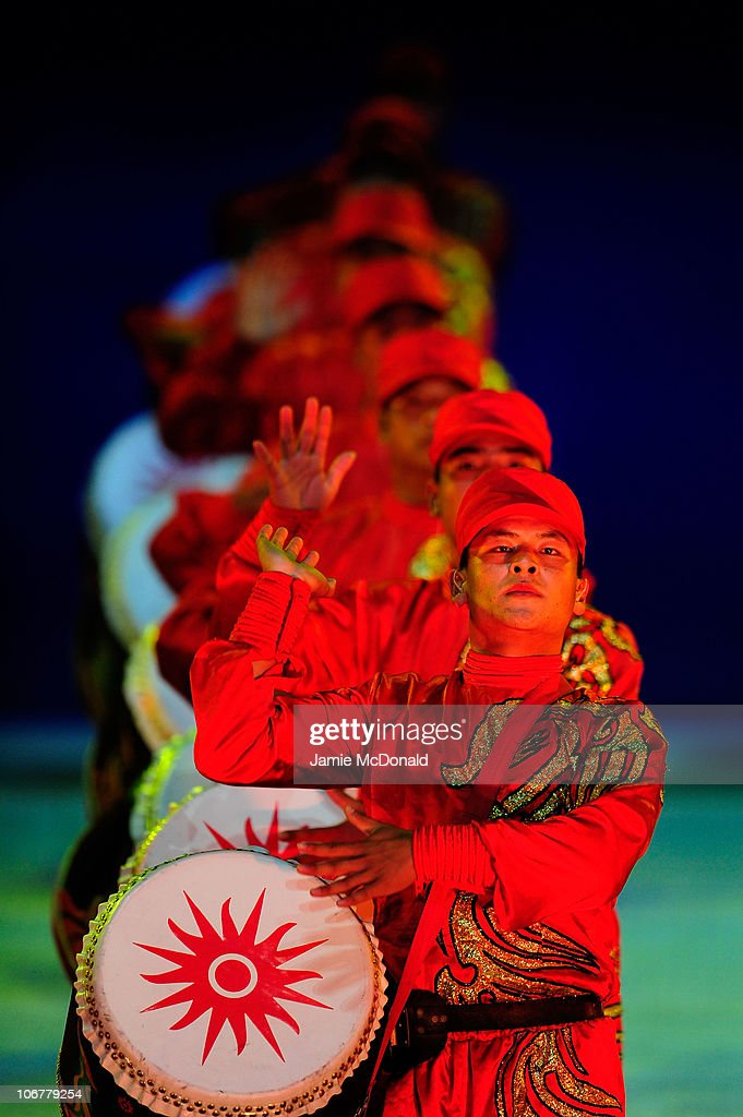 Drumers perform during the Opening Ceremony for the 16th Asian Games Guangzhou 2010 at Haixinsha Square on November 12, 2010 in Guangzhou, China.