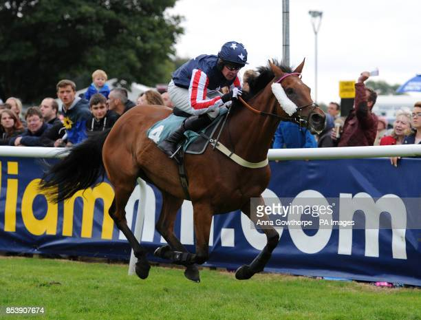 Drumlang ridden by Robert McCarth on their way to winning the William Hill On Your Mobile Handicap Steeple Chase at Cartmel Racecourse Cartmel Cumbria