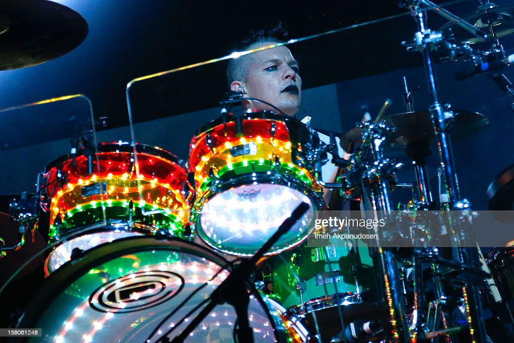 Drummer Adrian Young of No Doubt performs onstage at the 23rd Annual KROQ Almost Acoustic Christmas at Gibson Amphitheatre on December 9, 2012 in Universal City, California.