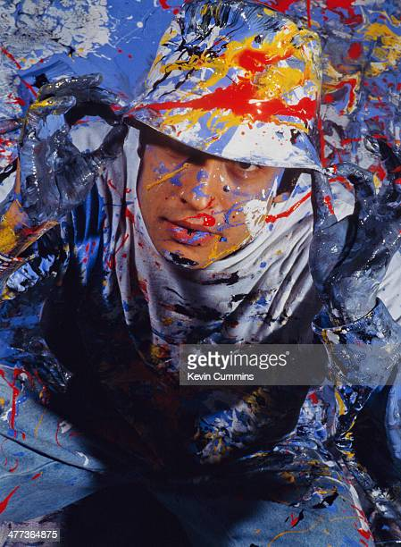 Drummer Alan 'Reni' Wren of the Stone Roses covered in paint during a photoshoot 5th November 1989