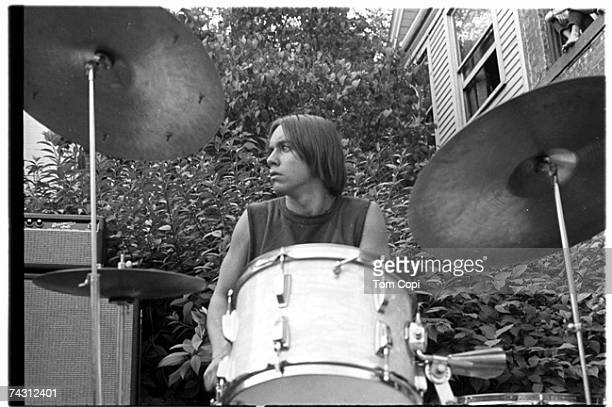 Drummer and student at the University of Michigan James Osterberg Jr performs with his band The Prime Movers in the front garden of a house on State...