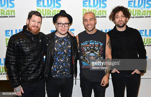 Drummer Andy Hurley vocalist/guitarist Patrick Stump bassist Pete Wentz and guitarist Joe Trohman of band 'Fall Out Boy' visit 'The Elvis Duran Z100...