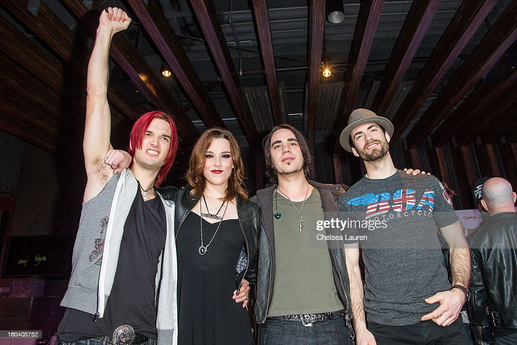 Drummer Arejay Hale, guitarist / vocalist Lzzy Hale, guitarist Joe Hottinger and bassist Josh Smith of Halestorm attend the Revolver Golden Gods Awards press conference at Hard Rock Cafe - Hollywood on January 30, 2013 in Hollywood, California.