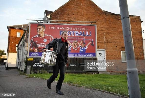 A drummer arrives for the Vanarama Conference local derby football match between Aldershot and Woking at The Electrical Services Stadium in Aldershot...