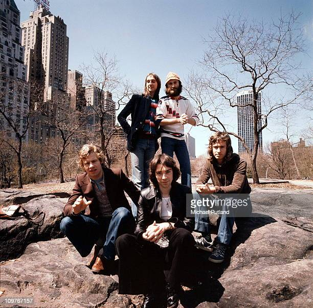 Drummer Bill Bruford bassist Mike Rutherford guitarist Steve Hackett singer Phil Collins and keyboard player Tony Banks in Central Park New York City...