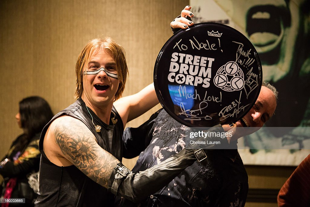 Drummer Bobby Alt (L) greets fans at Street Drum Corps' 'Lost Vegas' show at Hard Rock Hotel and Casino on January 26, 2013 in Las Vegas, Nevada.