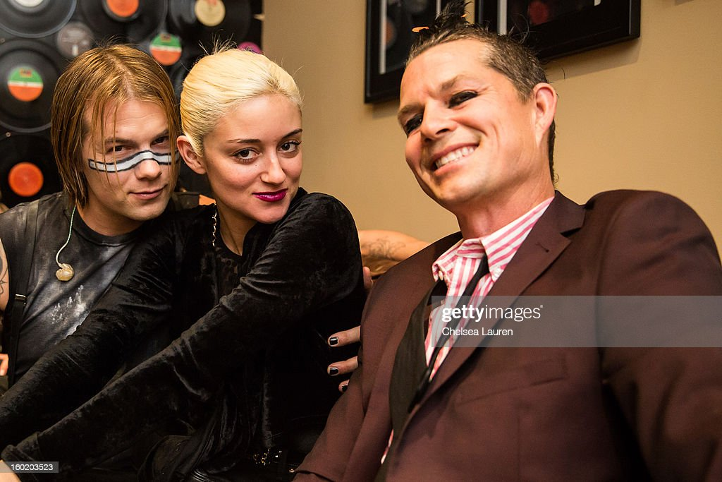 Drummer Bobby Alt, model Caroline D'Amore and drummer Adrian Young pose backstage at Street Drum Corps' 'Lost Vegas' show at Hard Rock Hotel and Casino on January 26, 2013 in Las Vegas, Nevada.