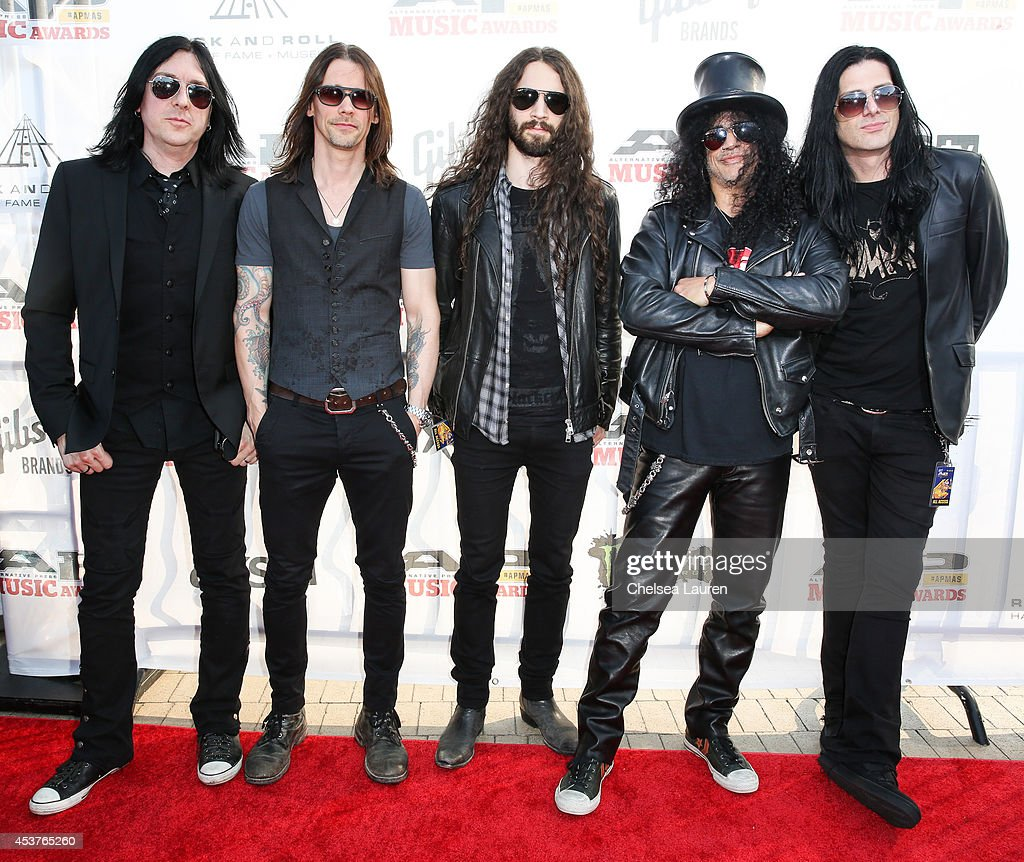 Drummer Brent Fitz vocalist Myles Kennedy guitarist Frank Sidoris guitarist Slash and bassist Todd Kerns of Slash featuring Myles Kennedy and The...
