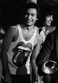 Drummer Charlie Watts and bassist Bill Wyman of the Rolling Stones going on stage at Wembley Empire Pool London 8th September 1973 Watts wears a vest...