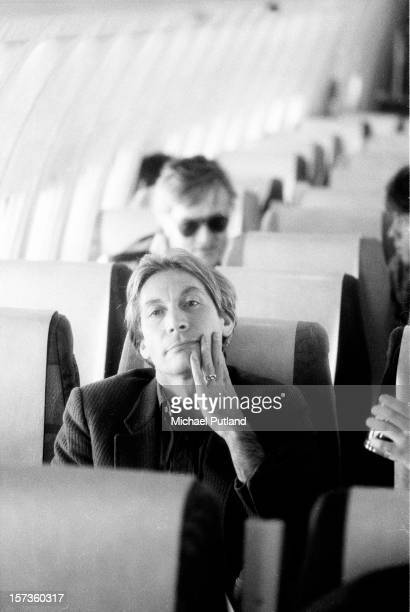 Drummer Charlie Watts of the Rolling Stones sits on a plane during their UK tour June 1982