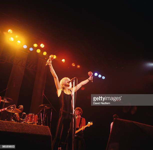 Drummer Clem Burke singer Debbie Harry and bassist Nigel Harrison of Blondie perform on stage at the Hammersmith Odeon in London England on September...